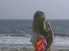 Woman lying beyond everything the wet beach