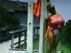 Biggest jugs blonde playgirl washes herself outside