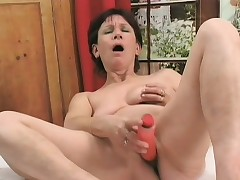 Horny milf plays on touching a sexual congress toy to the fore getting fucked by a young trestle