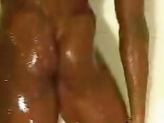 Black Female Bodybuilder seductive a shower 2